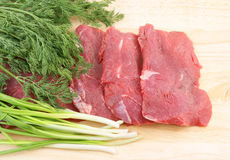 Raw beef meat with greens Royalty Free Stock Images