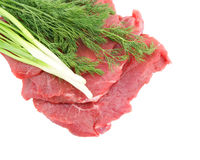 Raw beef meat with greens Royalty Free Stock Photos