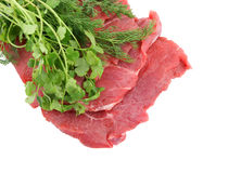 Raw beef meat with greens isolated Stock Photography