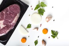 Raw beef meat and herbs with vegetables. On white background Stock Photography
