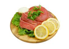 Raw beef meat with lemon isolated Stock Photos