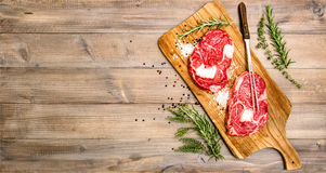 Raw beef meat Rib Eye Steak with herbs and spices Stock Images