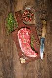 Raw beef meat Ribeye Steak with herbs and spices Royalty Free Stock Photography