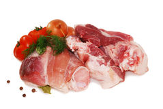 Raw beef meat. Shank steak with fresh vegetables isolated on a white background. Raw beef meat. Shank steak with fresh vegetables Stock Photos
