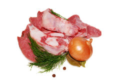 Raw beef meat. Shank steak with fresh vegetables isolated on a white background Royalty Free Stock Images