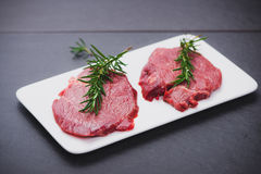 Raw beef meat sliced on a plate Royalty Free Stock Photo