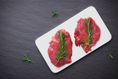 Raw beef meat sliced on a plate Royalty Free Stock Image