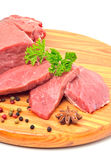 Raw beef and meat slices isolated on white. Raw beef and meat slices on the board isolated on white Stock Photos
