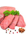 Raw beef, meat slices. And parsley isolated on white Royalty Free Stock Image