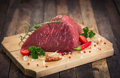 Raw beef meat with spices. On the table royalty free stock photography