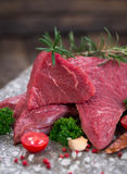 Raw beef meat with spices. On the table Royalty Free Stock Photos