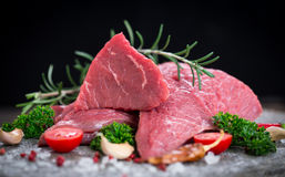 Raw beef meat with spices stock image