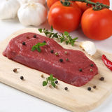 Raw beef meat steak on cutting board Royalty Free Stock Images