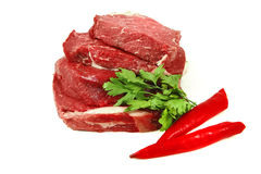 Raw beef meat steak over white Royalty Free Stock Photos