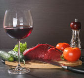 Raw beef meat with vegetables and wine Royalty Free Stock Image