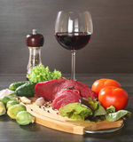 Raw beef meat with vegetables and wine Stock Photography