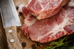 Raw Beef Meat on Wooden Cutting Board Royalty Free Stock Photo