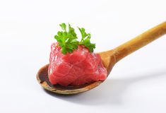 Raw beef meat on wooden spoon Stock Images