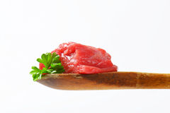 Raw beef meat on wooden spoon Royalty Free Stock Photos