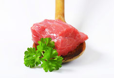 Raw beef meat on wooden spoon Stock Photo