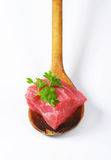 Raw beef meat on wooden spoon Stock Photography