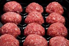 Raw beef meatballs in black plastick tray Stock Photos