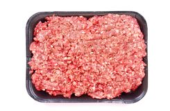 Beef mince raw. A black tray with healthy lean raw beef mince. Image isolated on white studio background Stock Photo