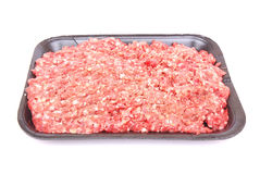 Raw beef mince. A black tray with healthy lean raw beef mince. Image isolated on white studio background Stock Image