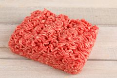 Raw beef minced meat. On a board Stock Images