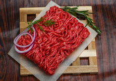 Raw beef minced meat. With rosemary and onion Stock Photo