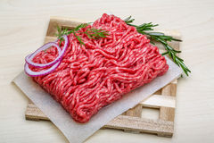 Raw beef minced meat. With rosemary and onion Royalty Free Stock Images