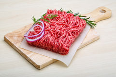 Raw beef minced meat. With rosemary and onion Stock Images