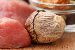 Raw beef with nutmeg. On wooden surface Royalty Free Stock Photography