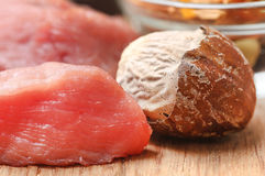 Raw beef with nutmeg. On wooden surface Stock Photo