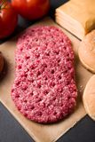 Raw beef patties for hamburger Royalty Free Stock Images