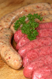 Raw beef and pork sausages Royalty Free Stock Images