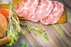 Raw beef, pork steak with herbs and spices Royalty Free Stock Image