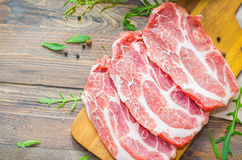 Raw beef, pork steak with herbs and spices Royalty Free Stock Images