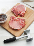 Raw beef or pork steak pounding Royalty Free Stock Image