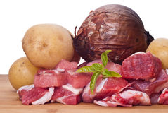 Raw beef, potatoes and onion. On white background Stock Photos
