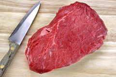 Raw Beef Red Meat Strip Fillet Steak And Kitchen Knife Royalty Free Stock Images