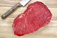 Raw Beef Red Meat Strip Fillet Steak And Kitchen Knife Royalty Free Stock Photos