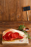 Raw beef Rib bone  steak   on wooden board and table Royalty Free Stock Images