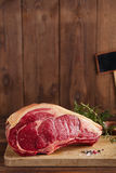 Raw beef Rib bone  steak   on wooden board and table Stock Image