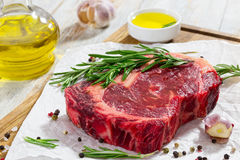 Raw beef rib eye fresh meat steak on chopping board Royalty Free Stock Photos