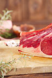 Raw beef Rib steak with bone on wooden board Royalty Free Stock Photo