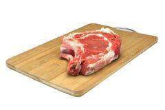Raw Beef Ribeye Steak On The Wood Cutting Board Isolated Royalty Free Stock Photo