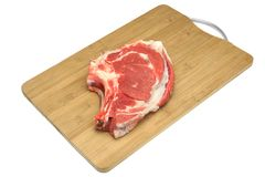 Raw Beef Ribeye Steak On The Wood Cutting Board Isolated Stock Photography