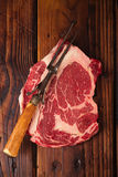 Raw beef Ribeye  steak   on wooden  table Stock Photography