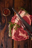 Raw beef Ribeye  steak   on wooden  table Royalty Free Stock Image